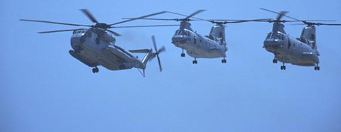 three large military helicopters in flight